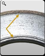 MONROE BRAKES®: Des rainures formant un arc sur les bords des plaquettes indiquent un flottement des plaquettes